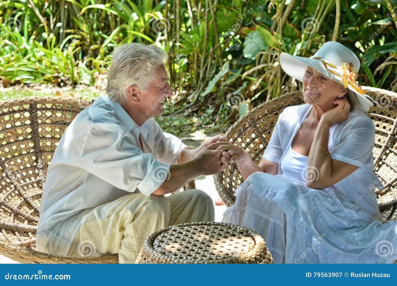 Elderly couple in tropical garden