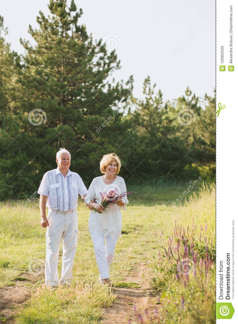91d7d2a5c23c Elderly Couple In The White Linen Dress Walk In Nature