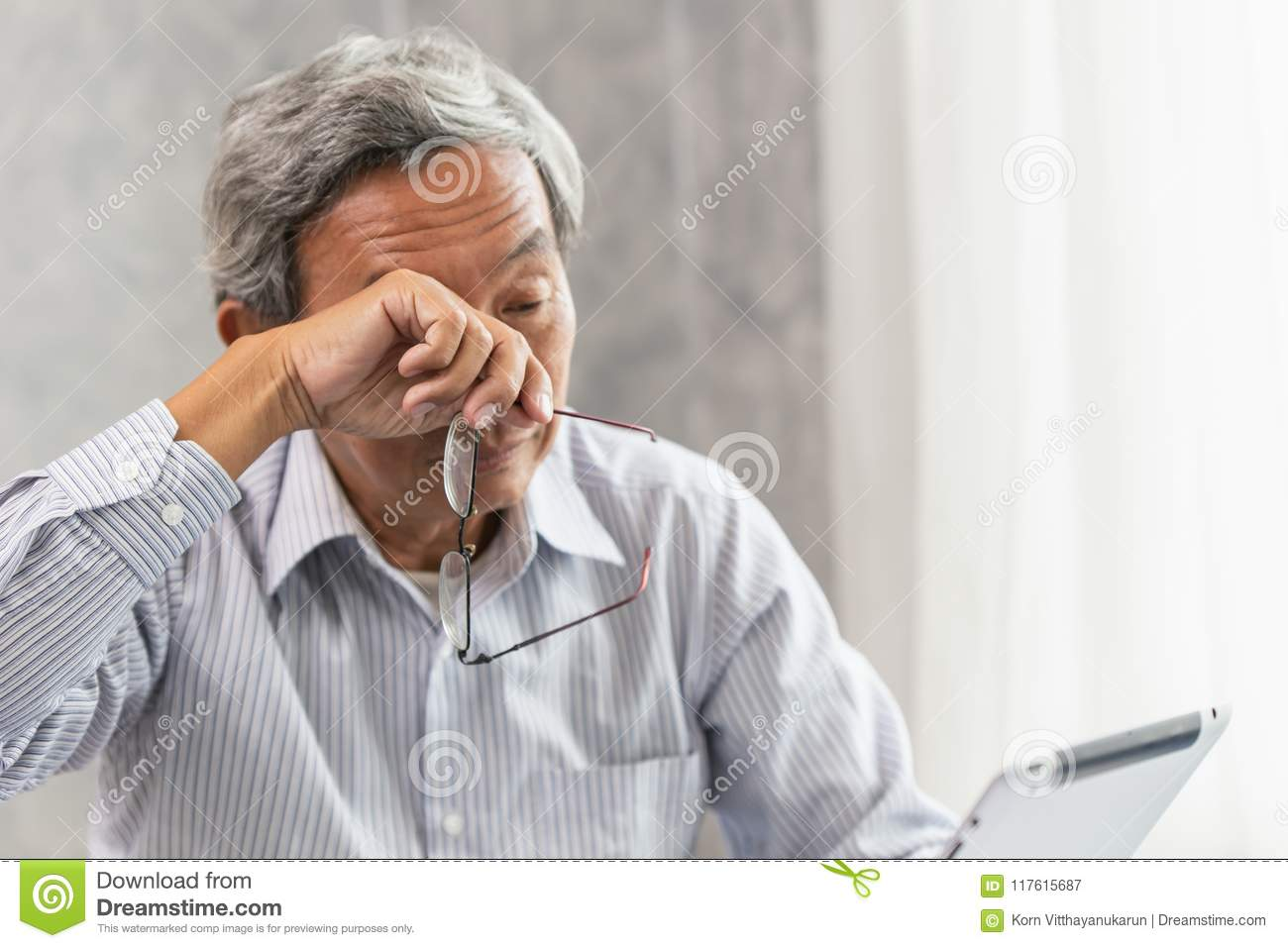 655eb8a2854 Asian elderly eye irritation problem fatigue and tired from hard work or  computer vision syndrome