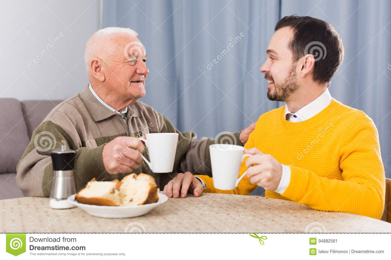 Elderly father and son breakfast