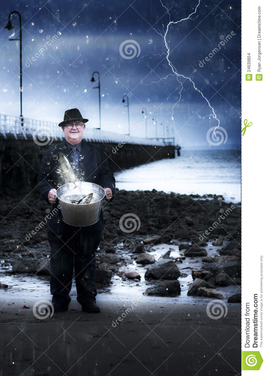 Elderly fisherman holding a bucket of fish stock images for Bucket of fish
