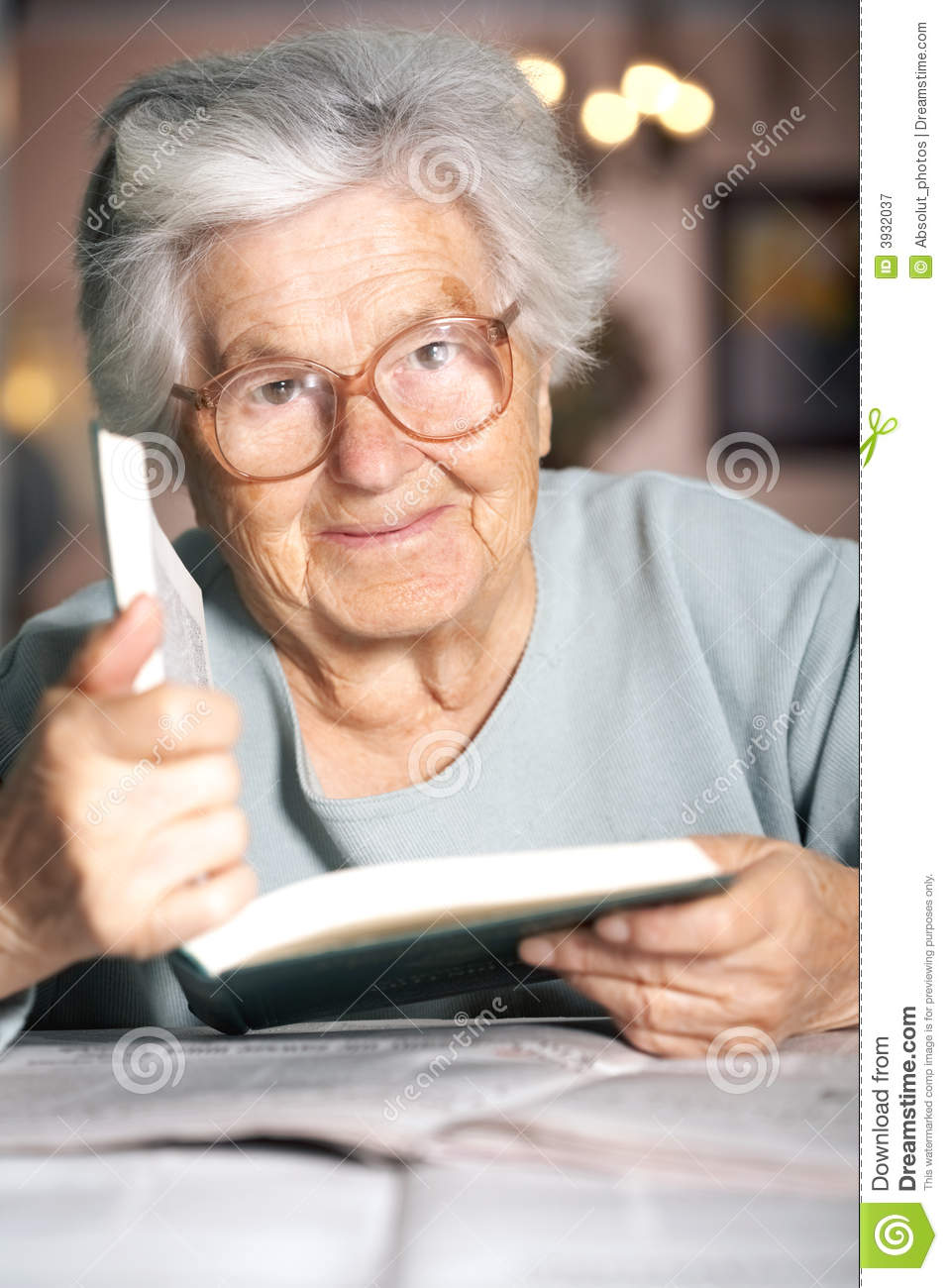 Elderly lady with a book