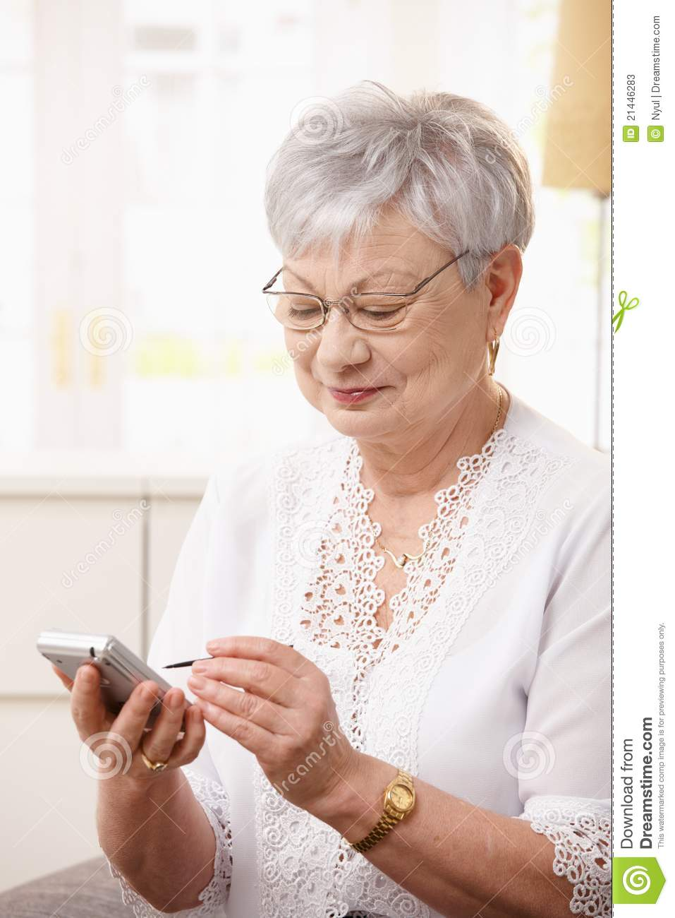 Stock Photos: Elderly lady using smartphone: www.dreamstime.com/stock-photos-elderly-lady-using-smartphone...