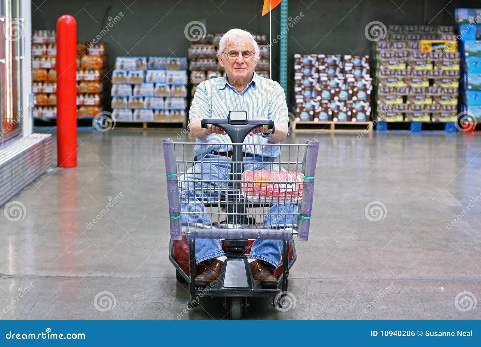 Elderly man drives motorized wheelchair royalty free stock for Motorized cart for seniors