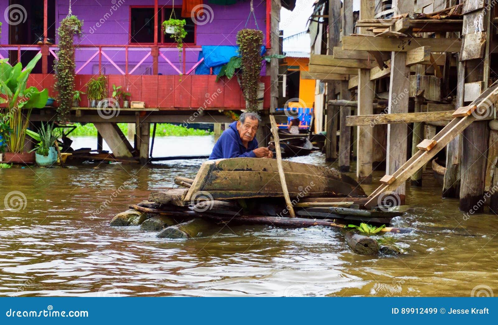 Elderly Man Fixing a Canoe
