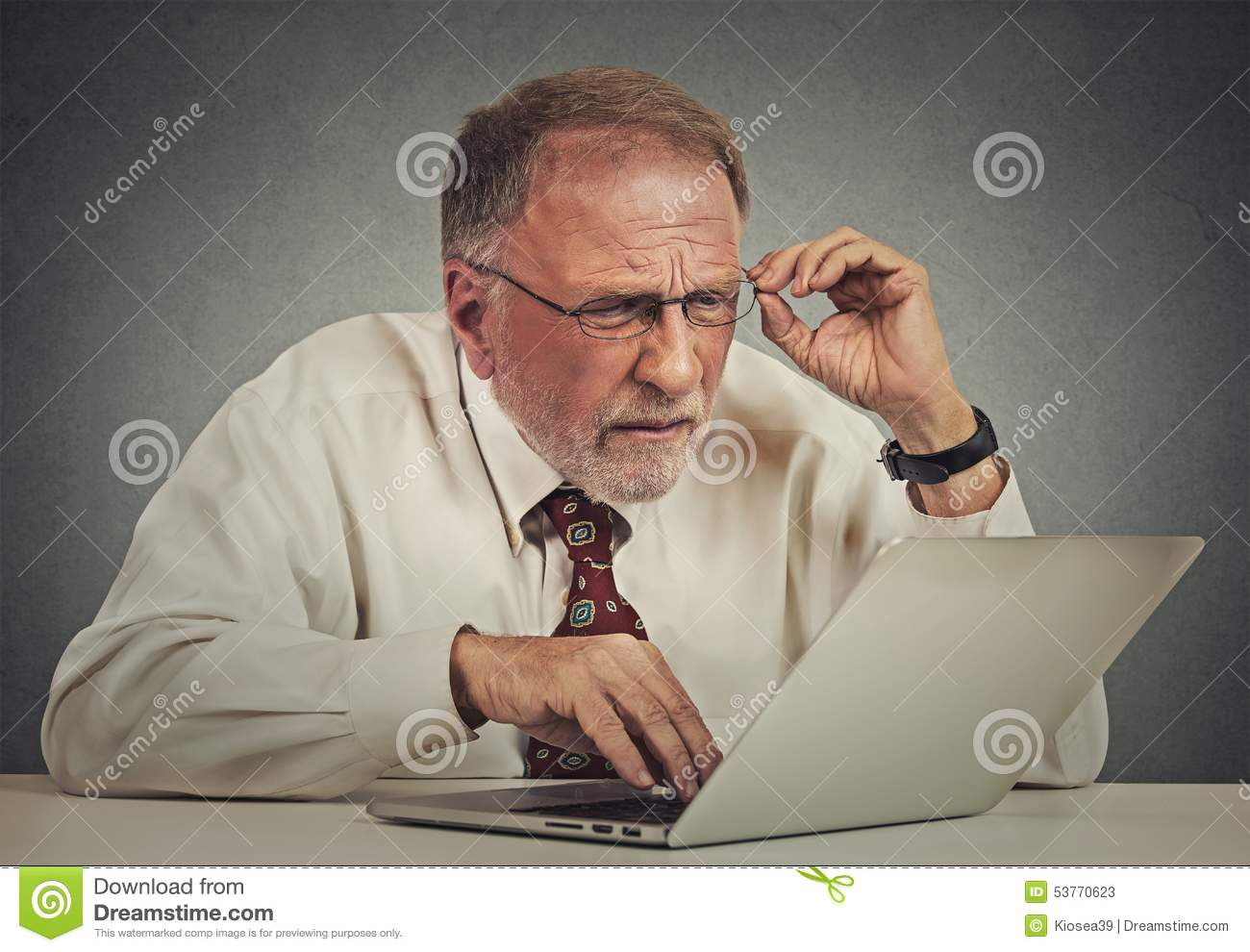1008af9bfe95 Closeup portrait senior elderly mature business man with glasses having  eyesight problems confused with laptop software isolated gray background.