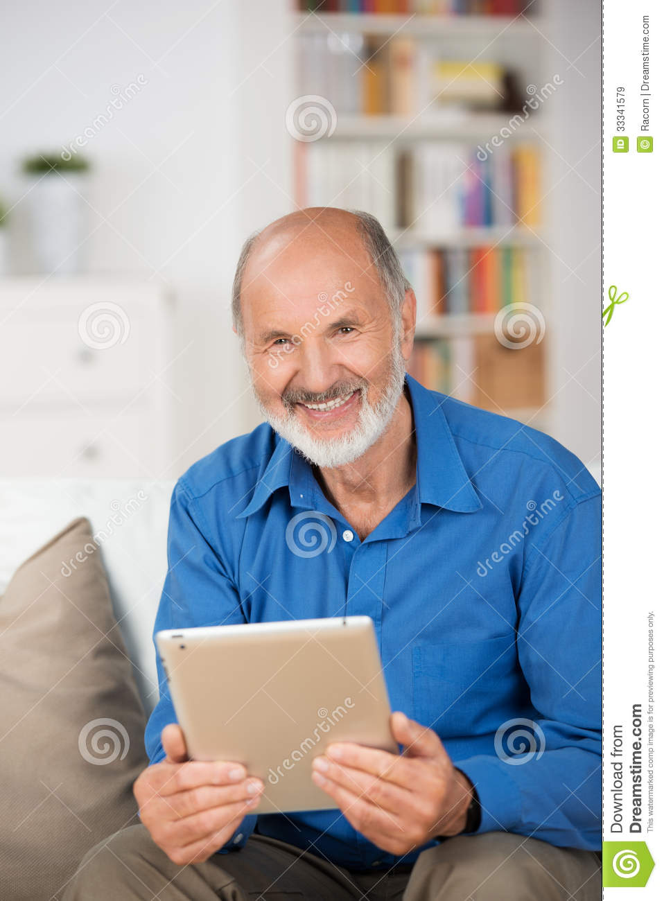 Elderly Man Holding A Tablet Pc Royalty Free Stock Images