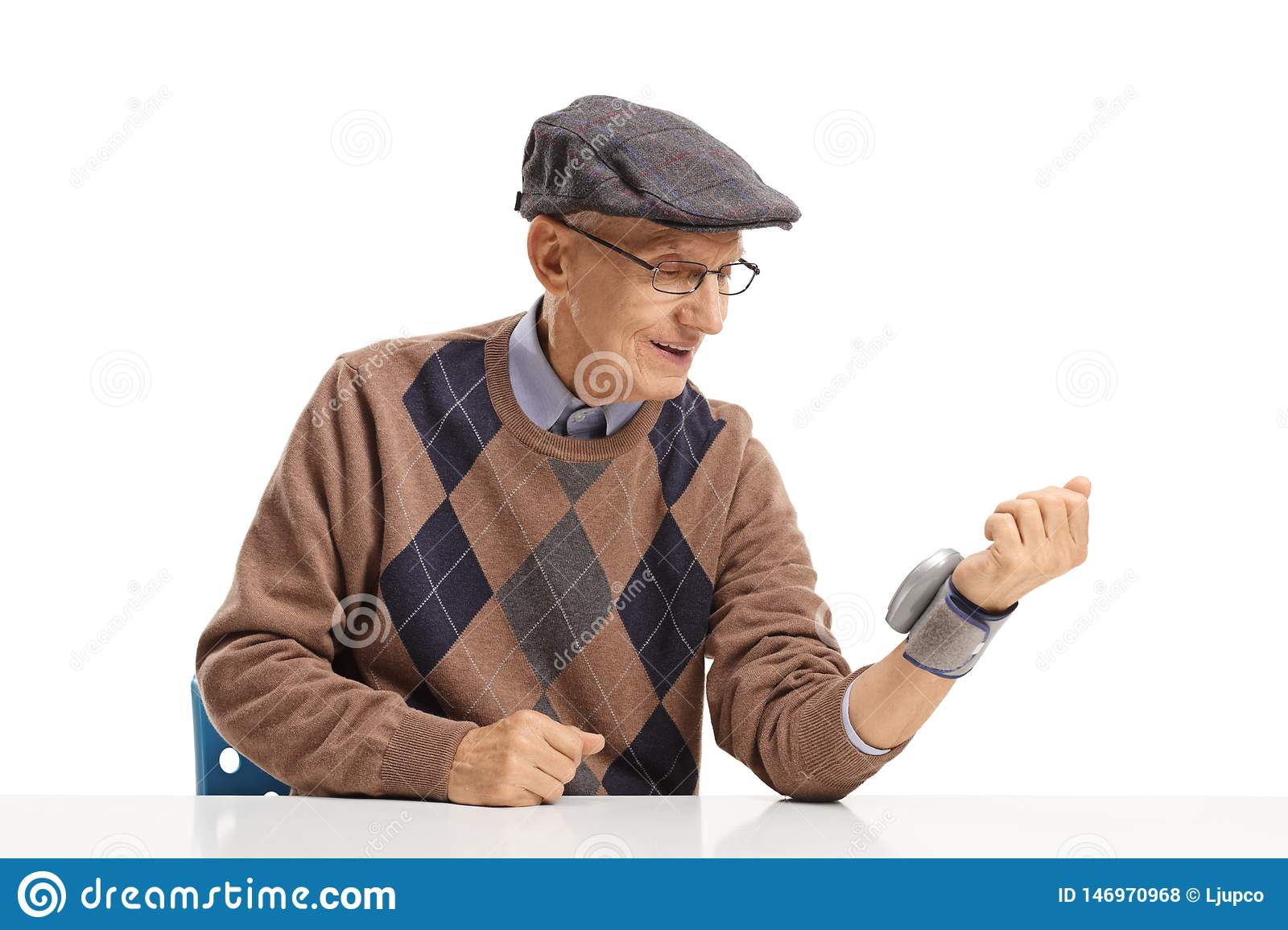 Elderly man measuring blood pressure with a wrist device