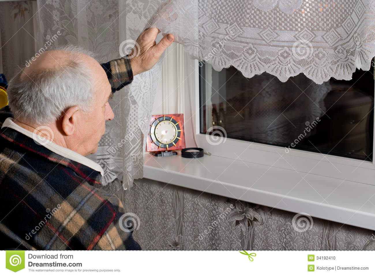 man looking out window at night elderly man peering out
