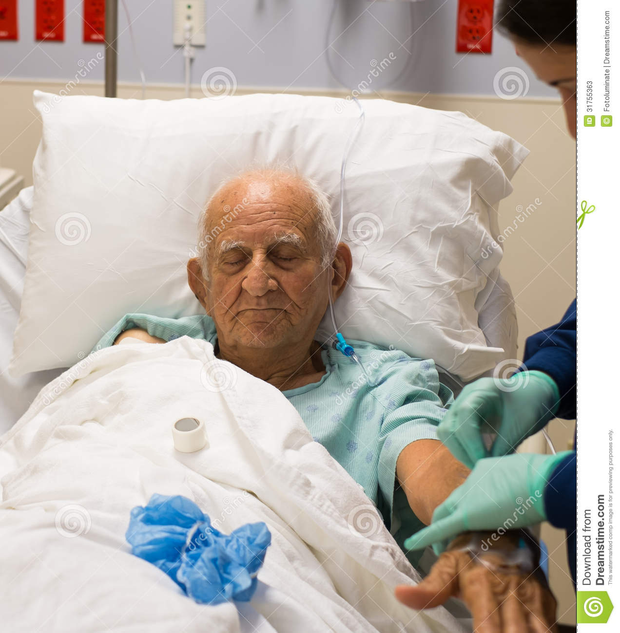 Elderly Person In A Hospital Bed