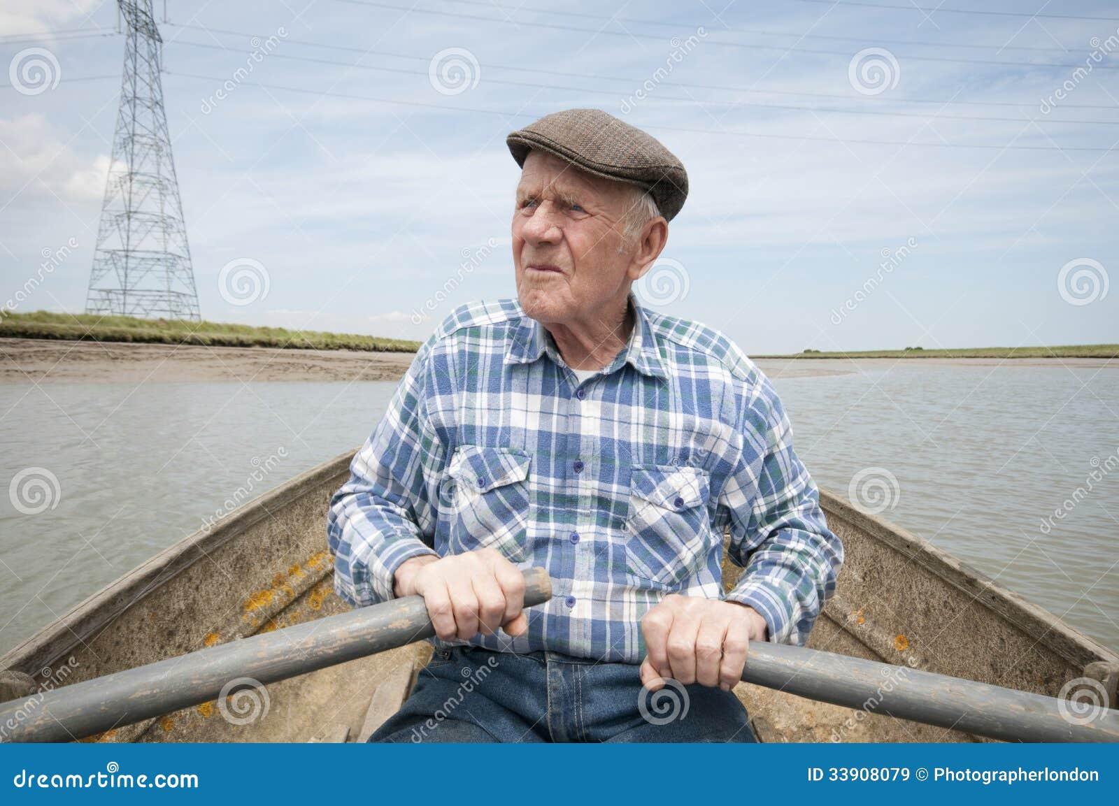 Elderly man rowing boat royalty free stock images image for Senior fishing license