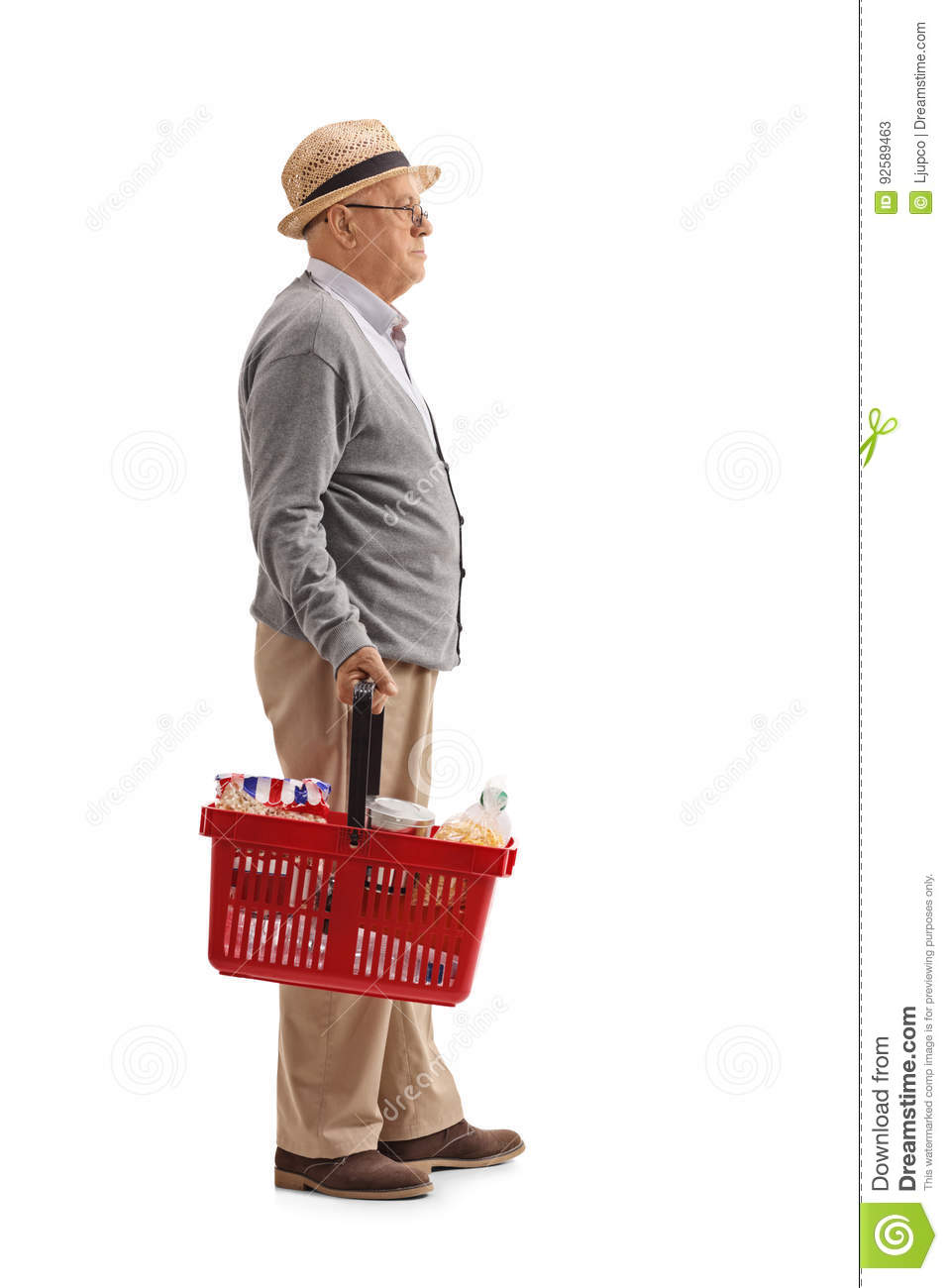Elderly man with a shopping basket waiting in line