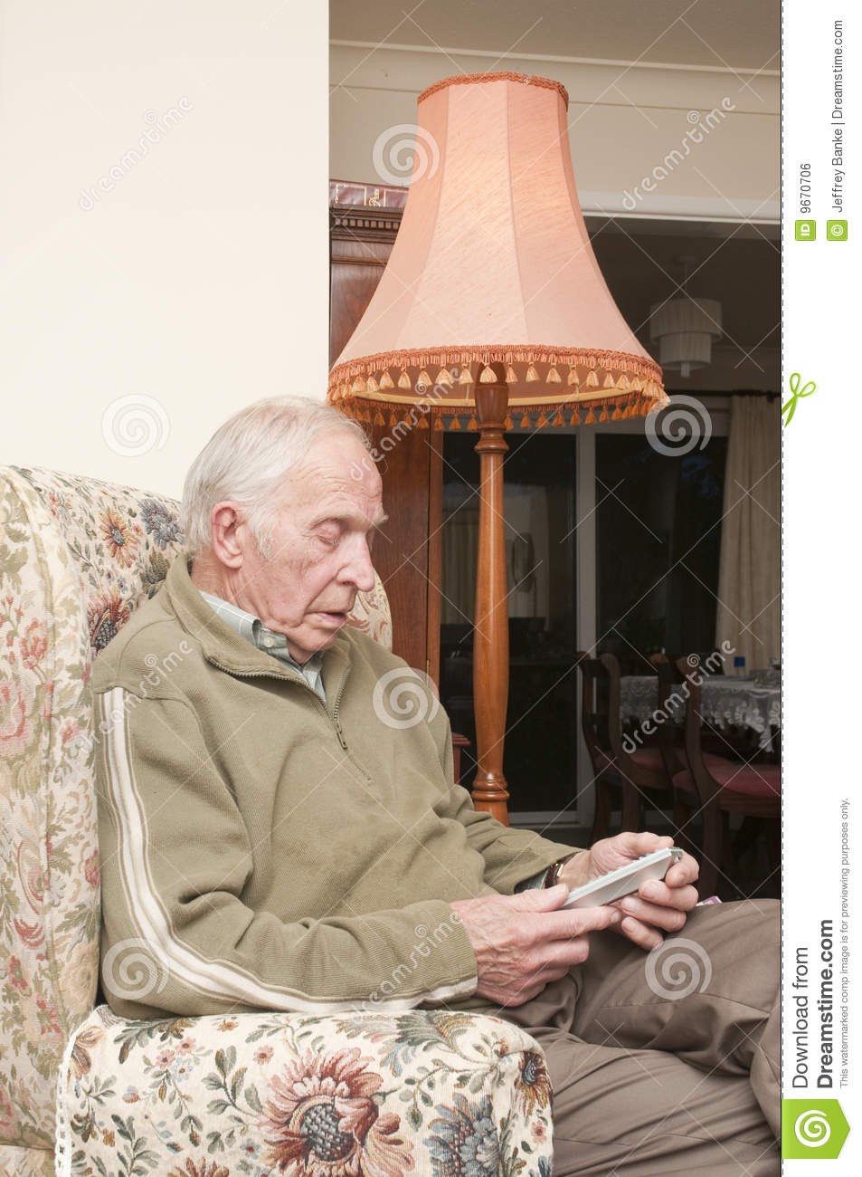 Elderly man sitting in armchair royalty free stock image for Sitting in armchair