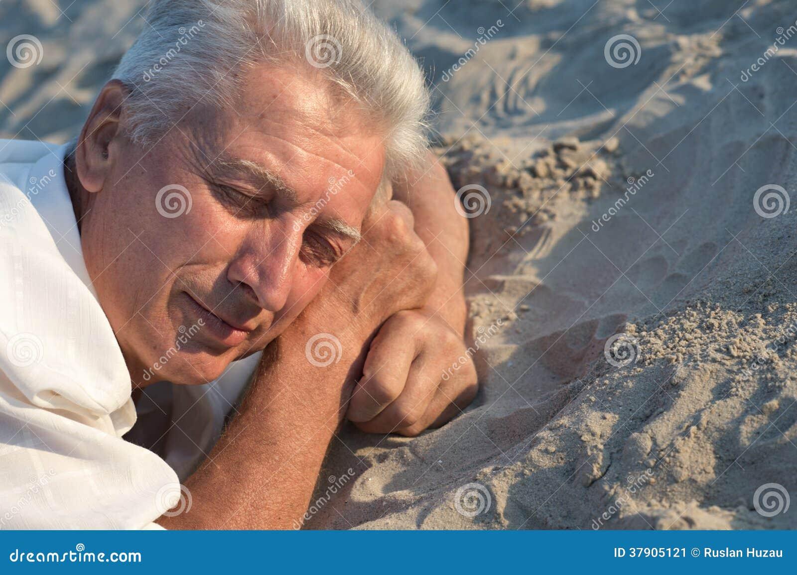 Closeup Of Man Sleeping On The Beach Royalty Free Stock