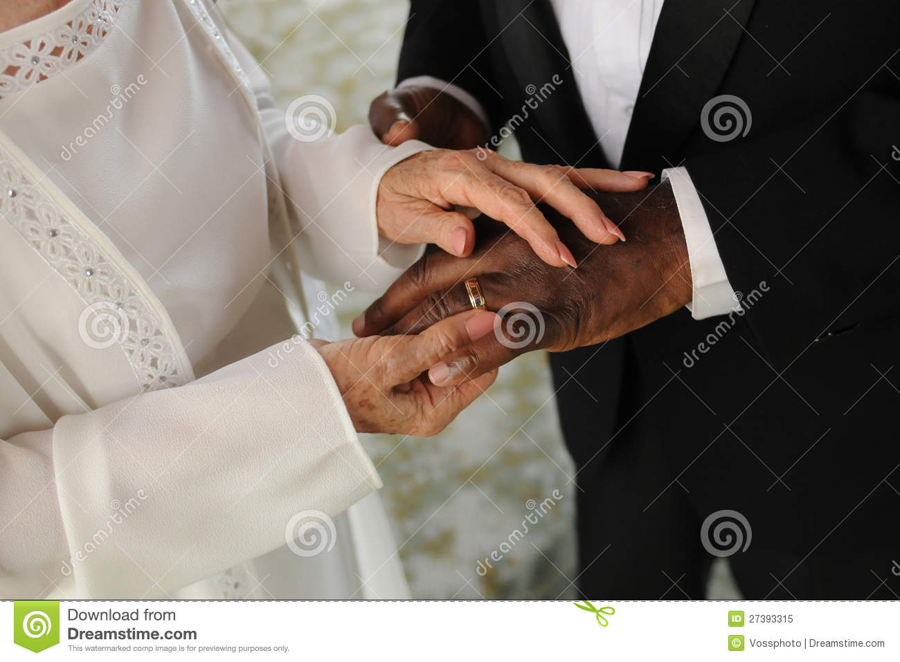 Elderly Mixed Couple Exchanging Wedding Rings Royalty Free