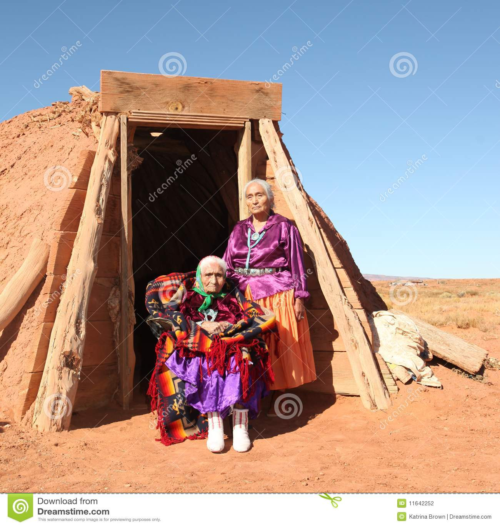 Elderly Native American women pose outside a tribal abode  They are    Native American Tribal Women