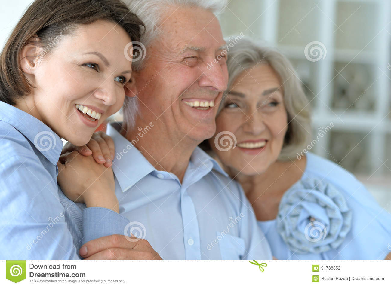 Elderly parents and their adult daughter