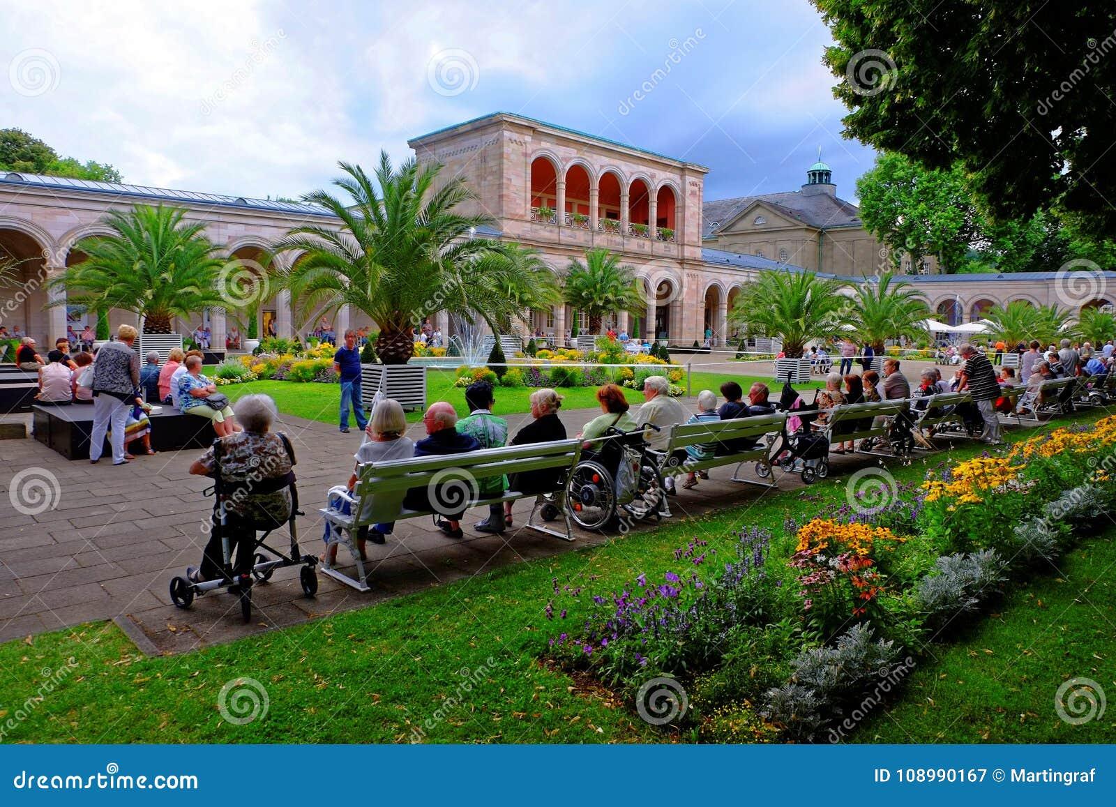 Elderly people together in park - European future generation