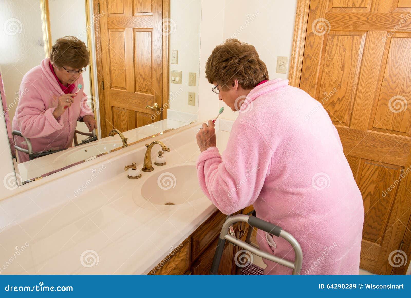 Elderly Senior Woman Brushing Teeth