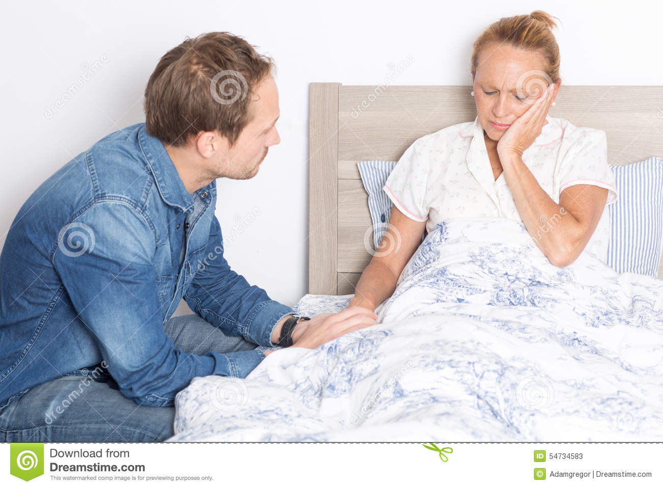elderly son takes care of ill mother in bed stock image image of senior nurse 54734583. Black Bedroom Furniture Sets. Home Design Ideas