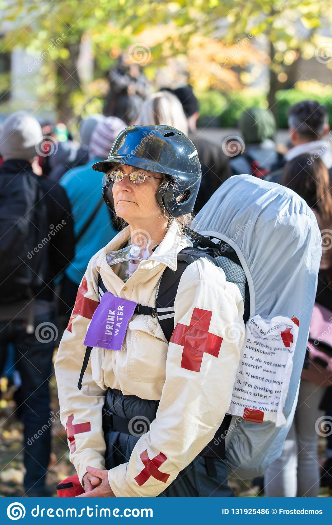 Elderly woman as a street medic during political protest