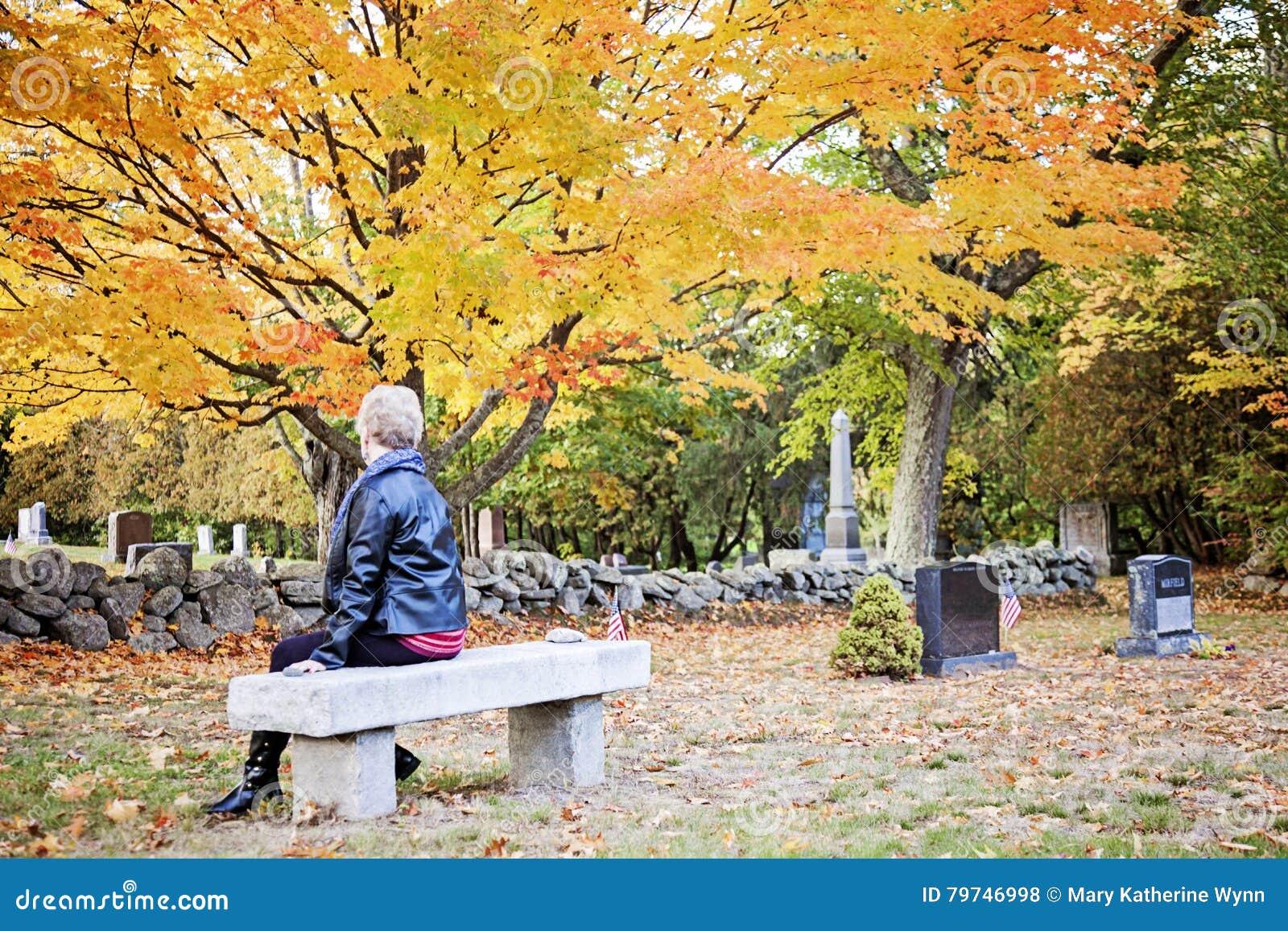 Elderly woman in cemetery
