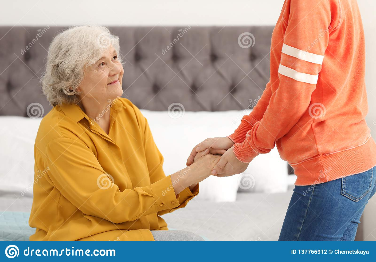 Elderly woman with female caregiver