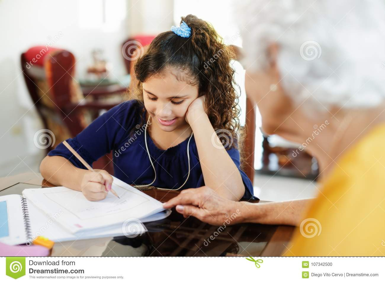 Happy Little Girl Doing School Homework With Elderly Women At Home Family Relationship With Grandmother And Granddaughter
