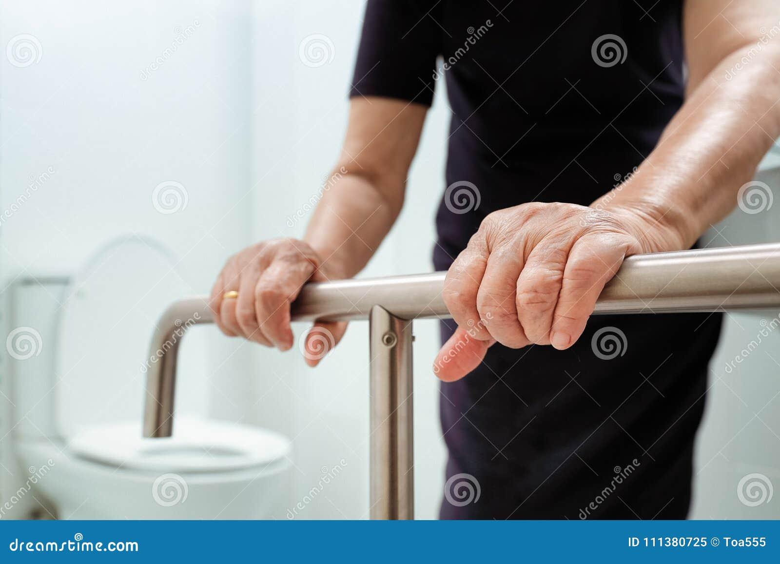 Download Elderly Woman Holding On Handrail In Bathroom. Stock Image   Image  Of Bathroom,