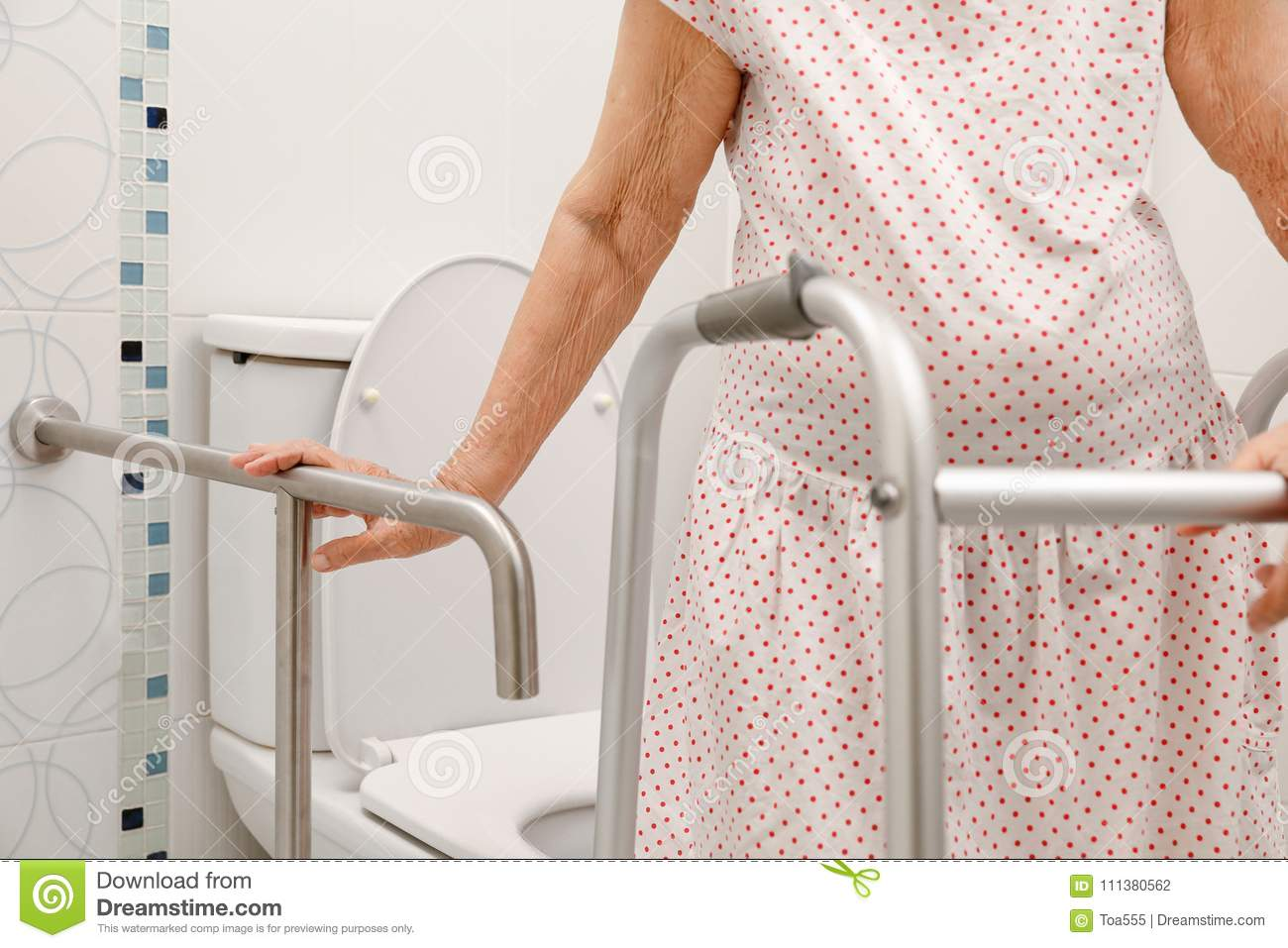 Elderly Woman Holding On Handrail In Toilet. Stock Photo - Image of ...