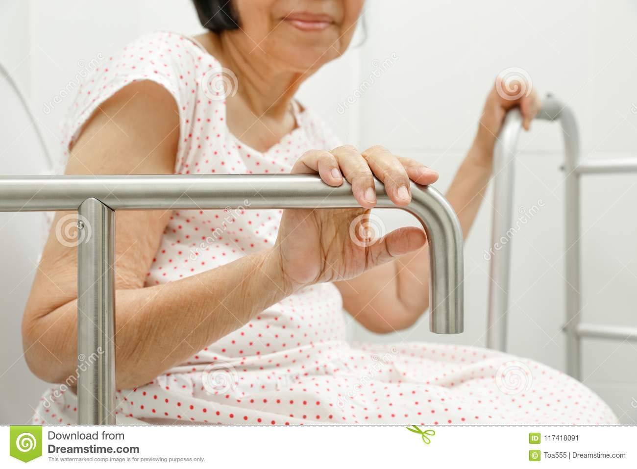 Elderly Woman Holding On Handrail In Toilet. Stock Image - Image of ...