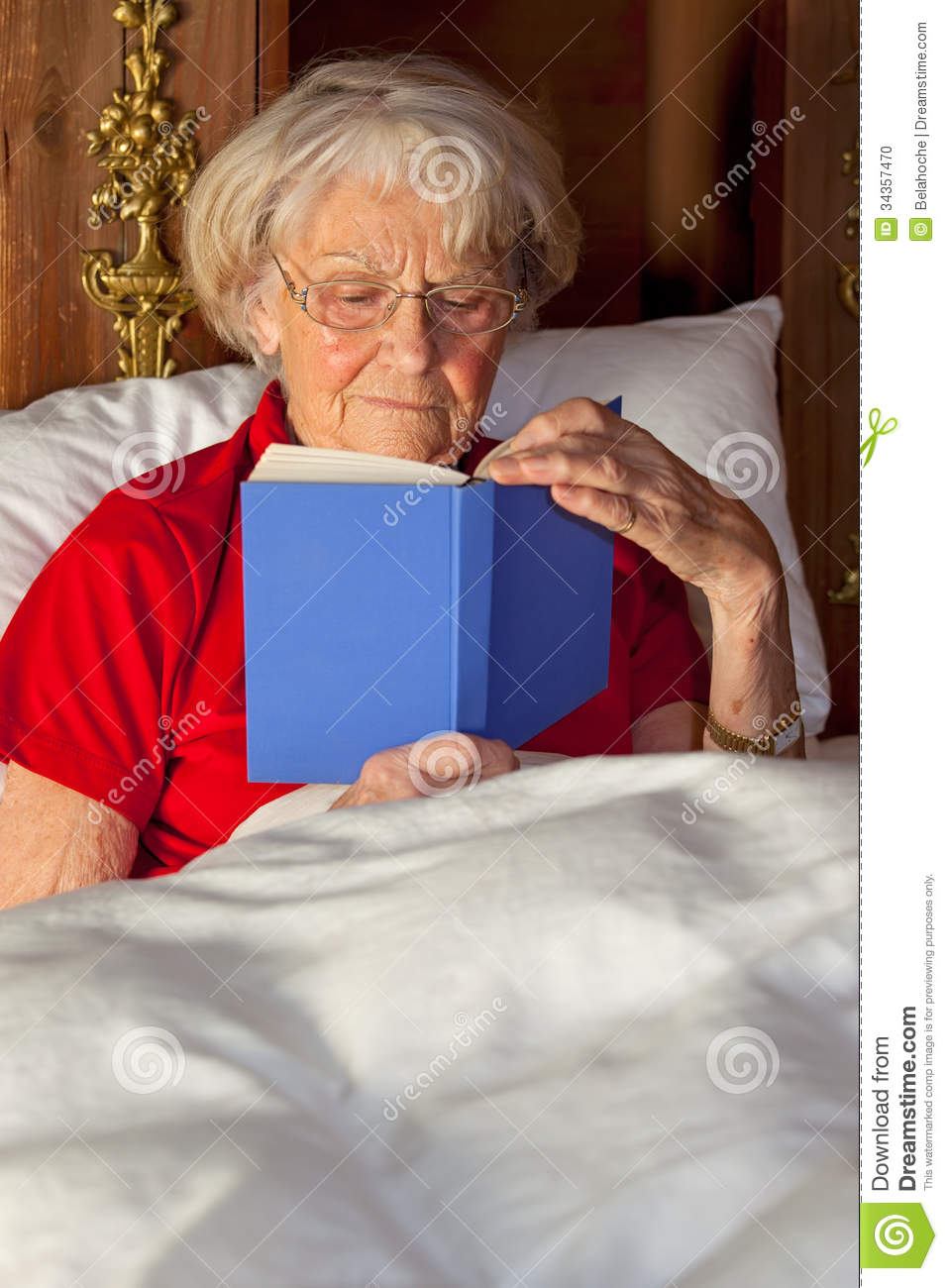 Elderly Woman Reading In Bed Stock Photo Image Of Elderly