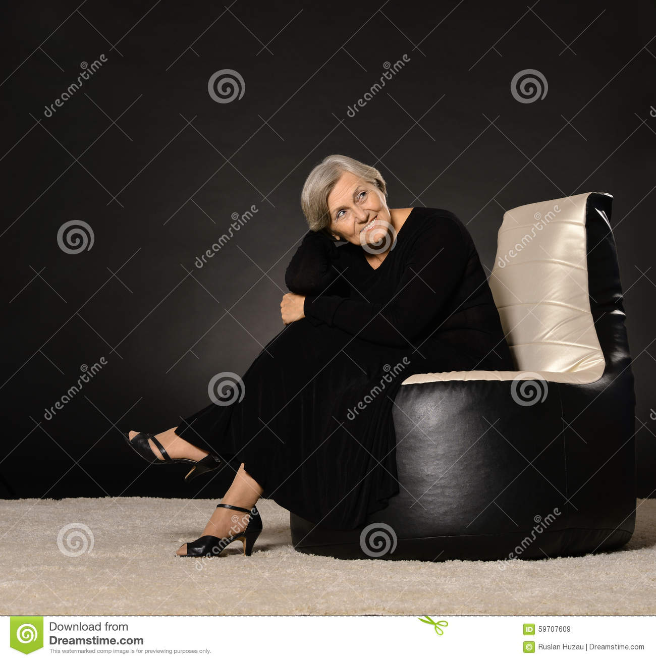Elderly woman sitting on armchair stock photo image for Sitting in armchair
