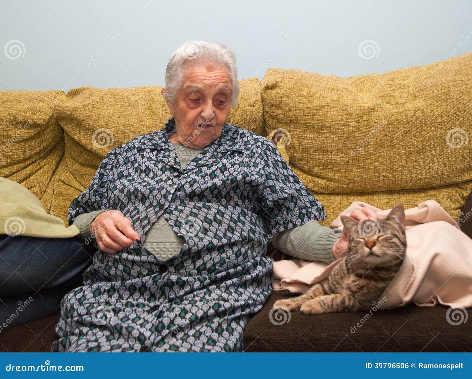 Elderly woman stroking her cat