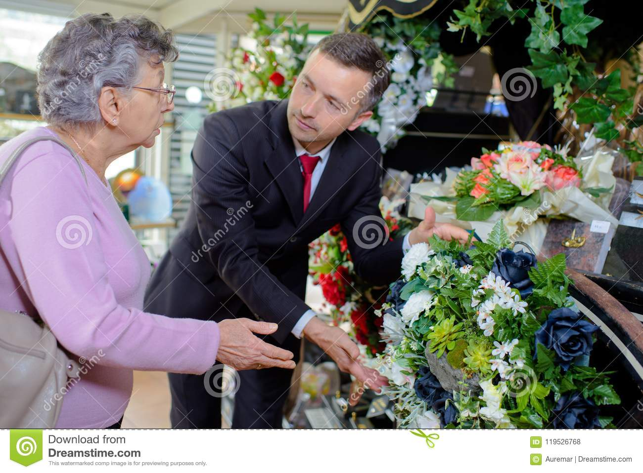 Elderly Woman Buying Flowers At Funeral Service Stock Photo Image