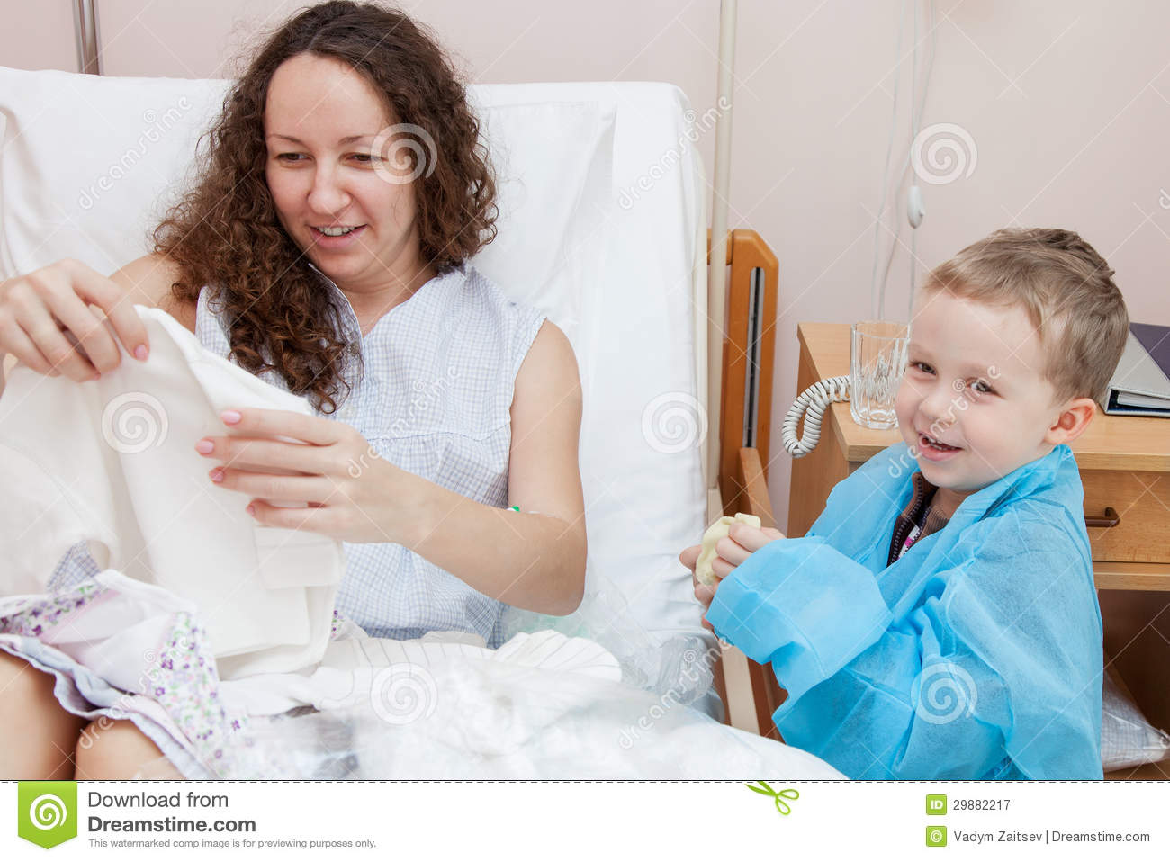 Son Visiting Mother In Hospital Royalty Free Stock