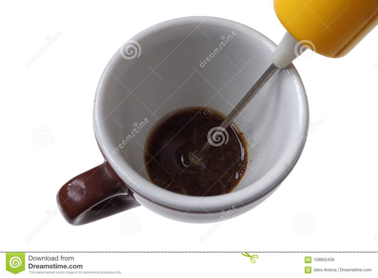 Electric beater for instant coffee and cup isolated on white