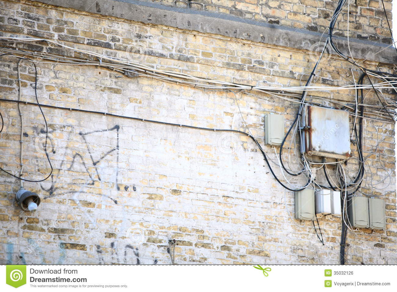 electric controller box and tangle of cables on brick wall stock rh dreamstime com wiring through brick wall Wall Electrical Wiring