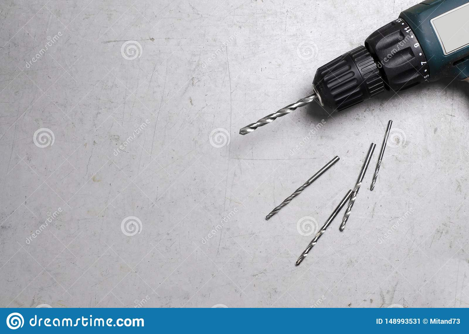 Electric drill on grey background. Space for text