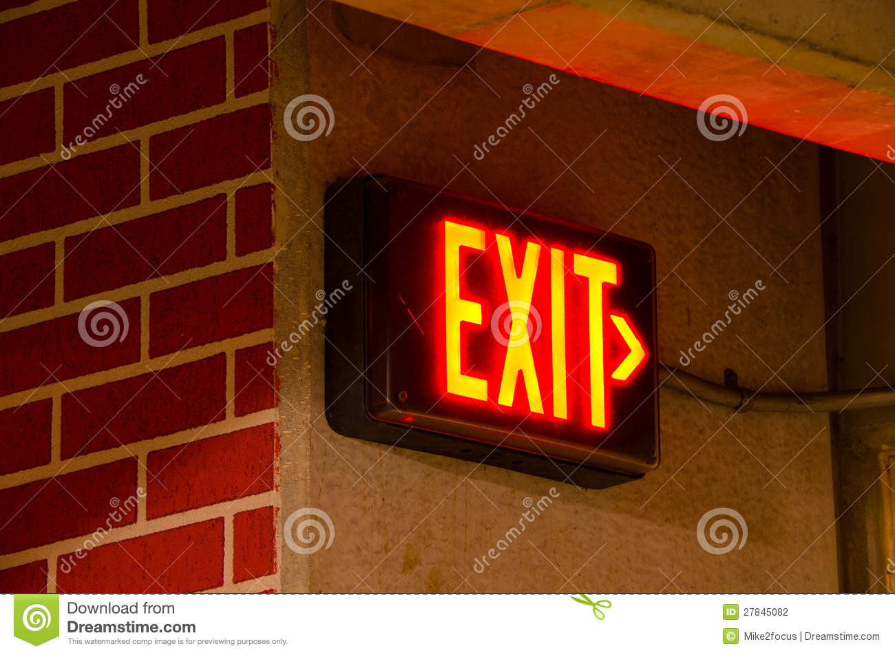electric exit sign on brick concrete wall at night stock. Black Bedroom Furniture Sets. Home Design Ideas