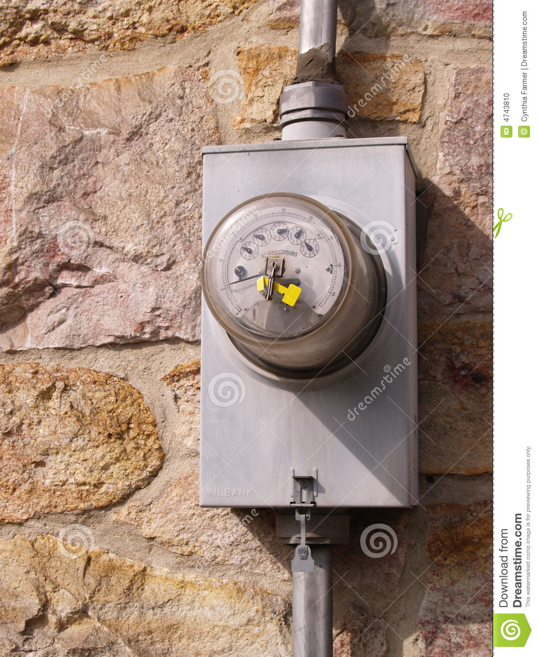 Electric meter by a stone wall