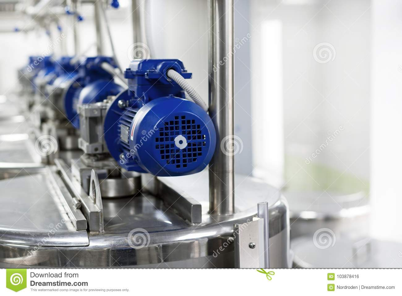 Electric motors on steel tanks for mixing liquids, modern production of alcoholic beverages.