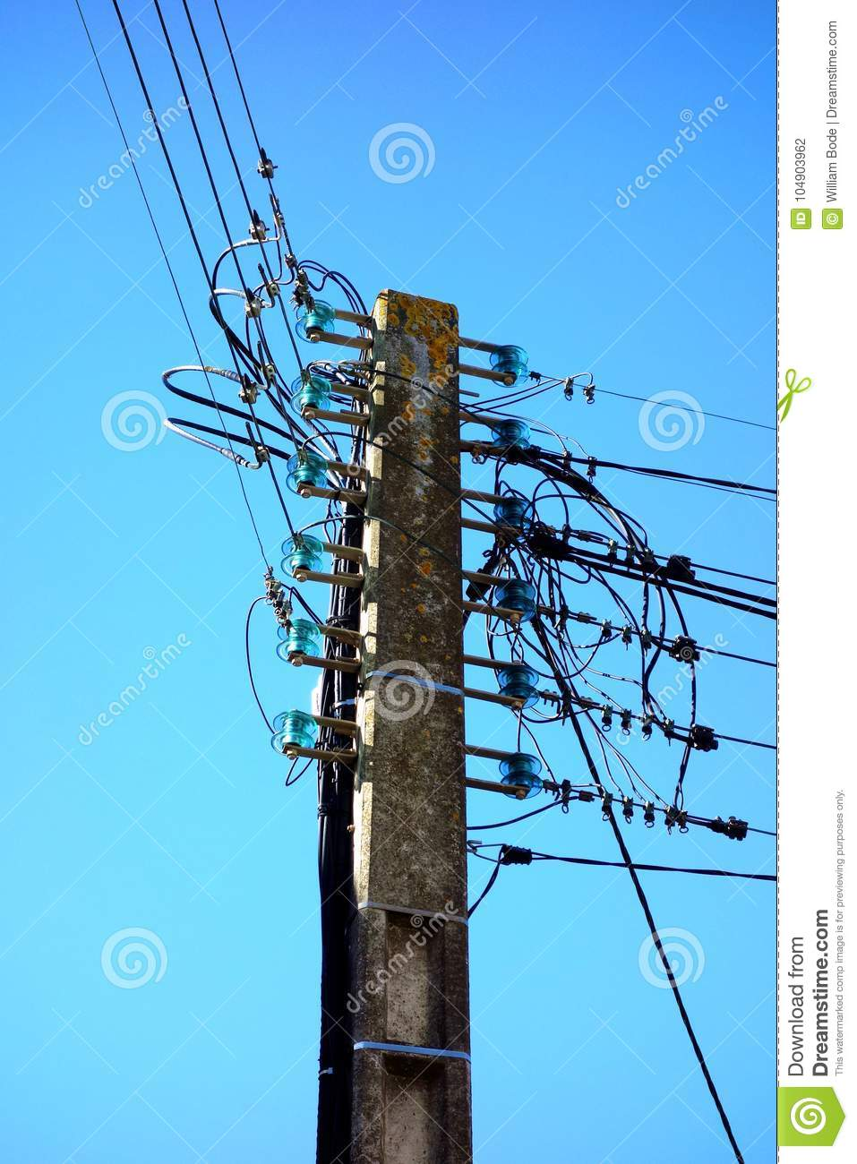 electric pole with old glass insulators stock photo