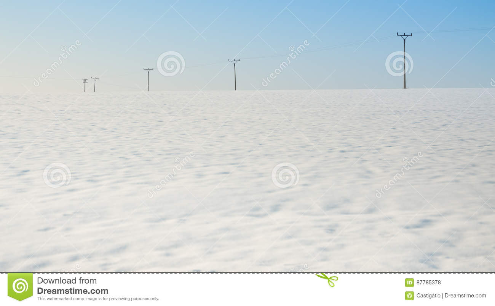 Electric poles in the field, winter season