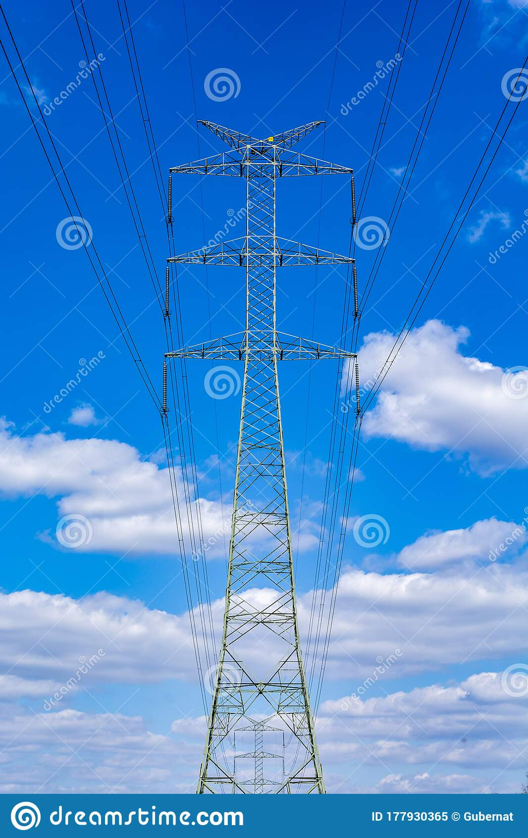 Electric Power Transmission Power Line Pole High Power Electrical Transmission Tower Against The Blue Sky And White Billowing Stock Image Image Of Engineering Distribution 177930365