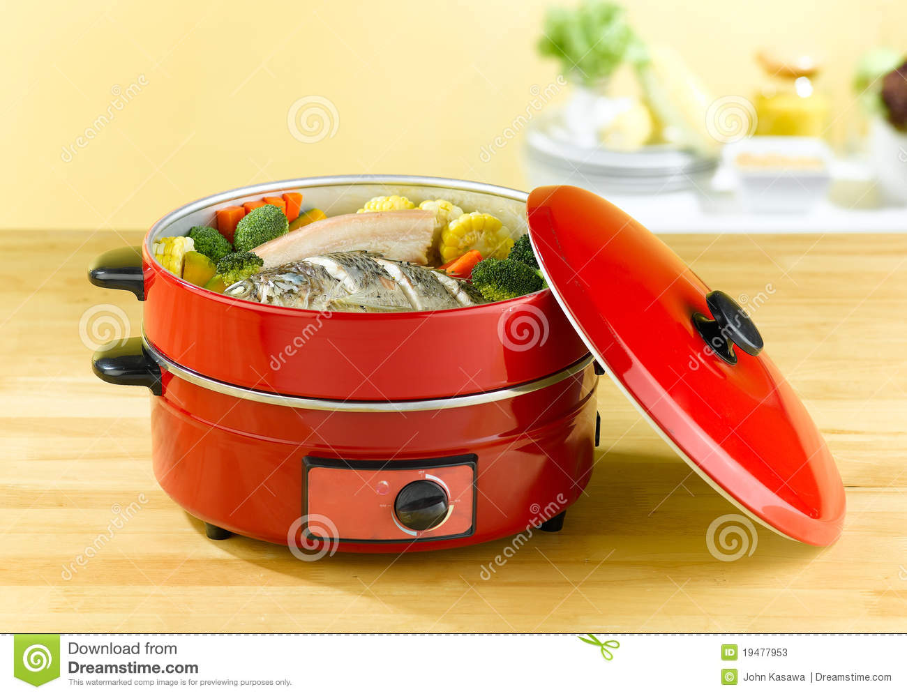 Electric Steam Cooking ~ Electric steaming cooking pot stock image of steam