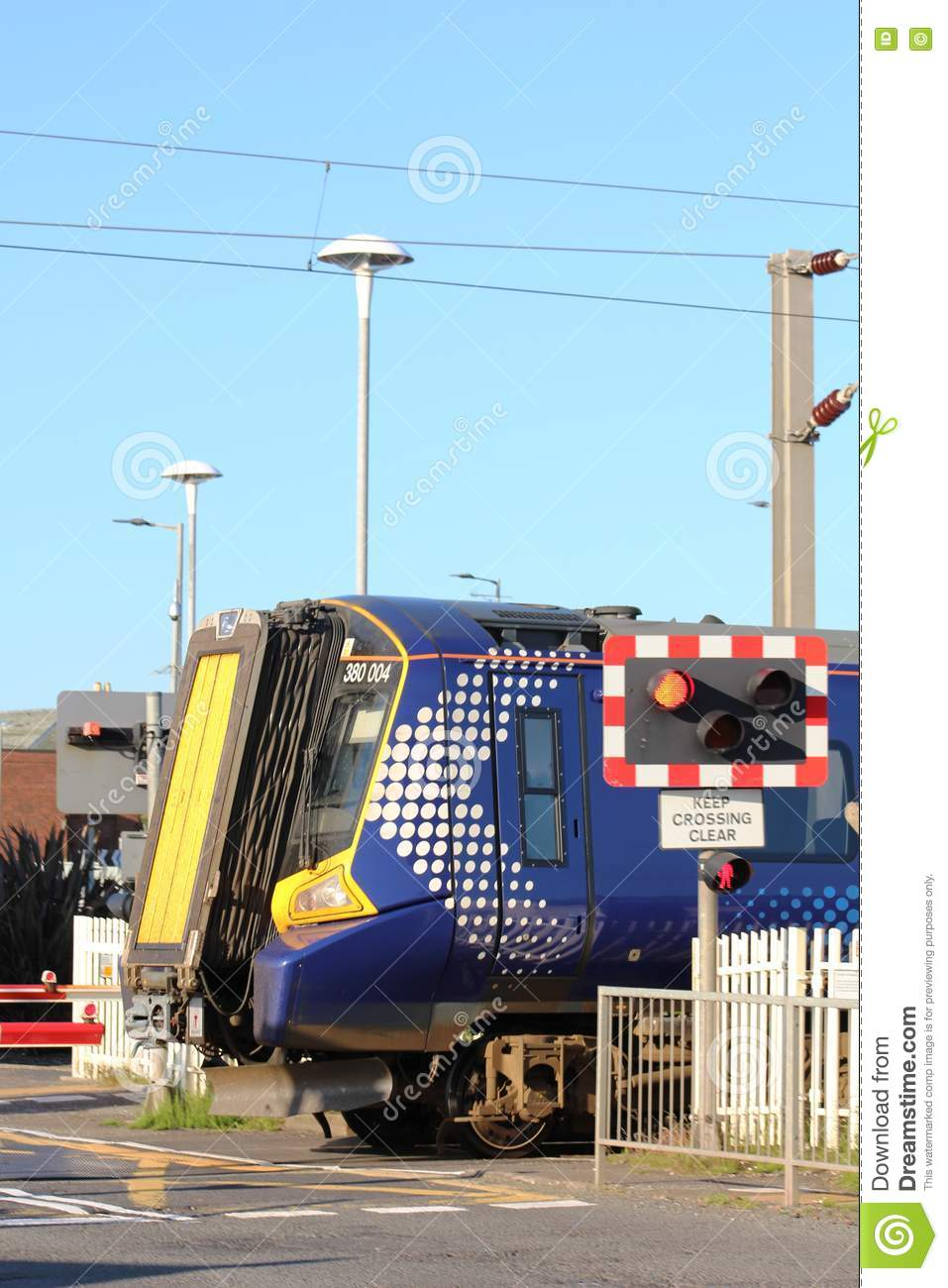 Electric Train, Scotrail Livery, At Level Crossing Editorial