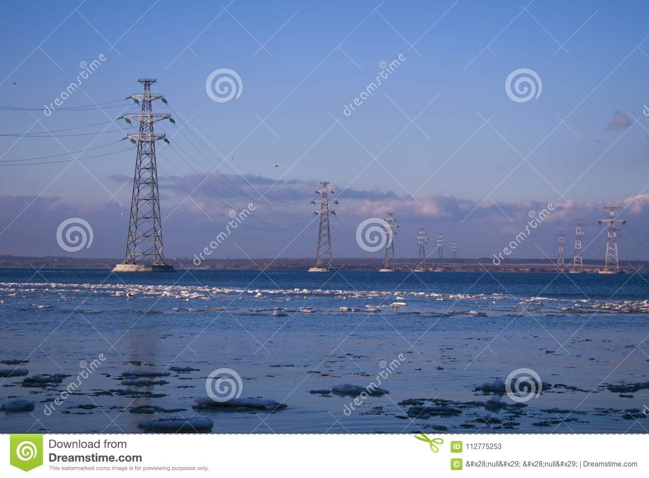 The electric transmission line passing through the river against