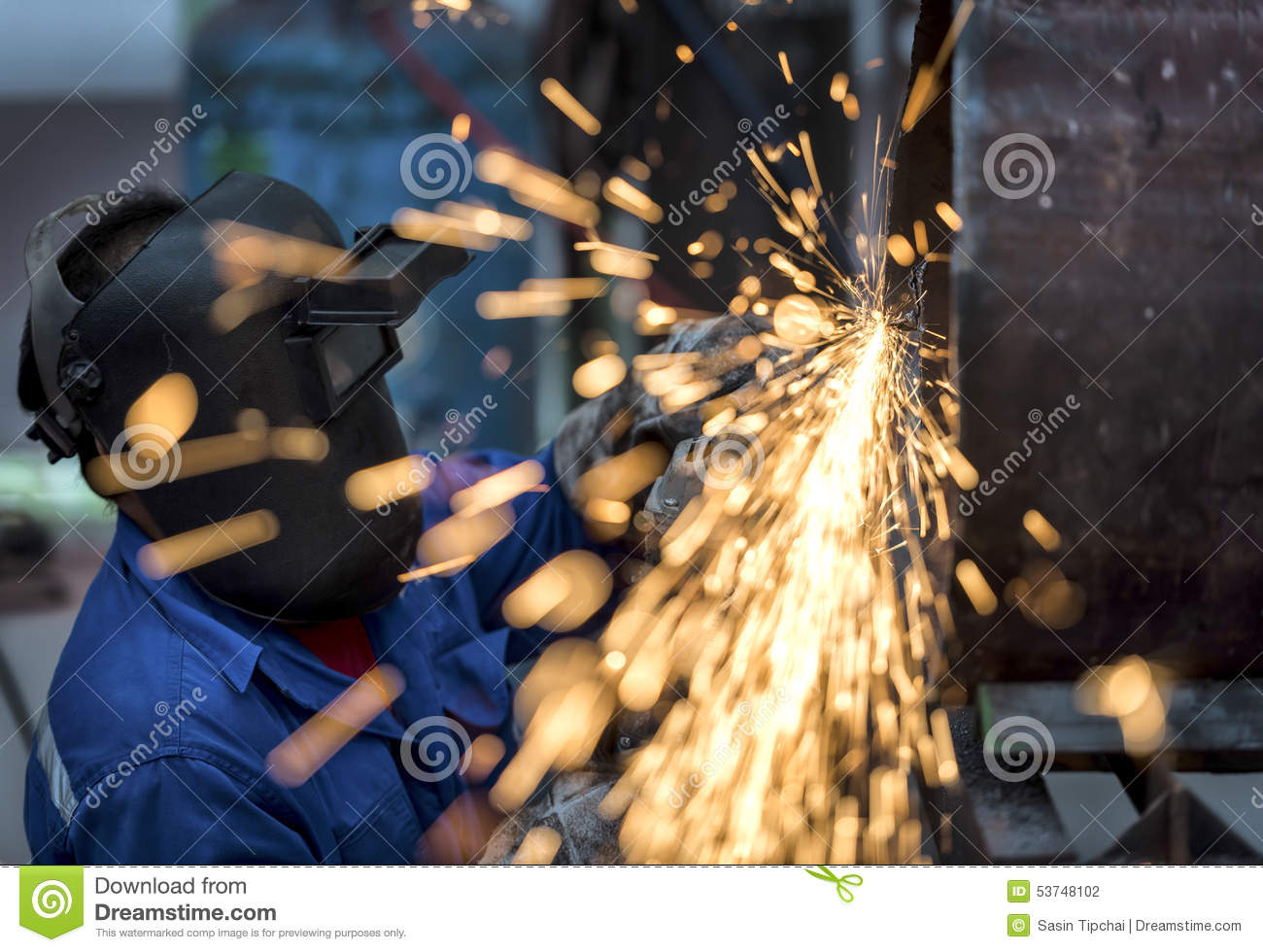 Electric wheel grinding on steel pipe stock photo image