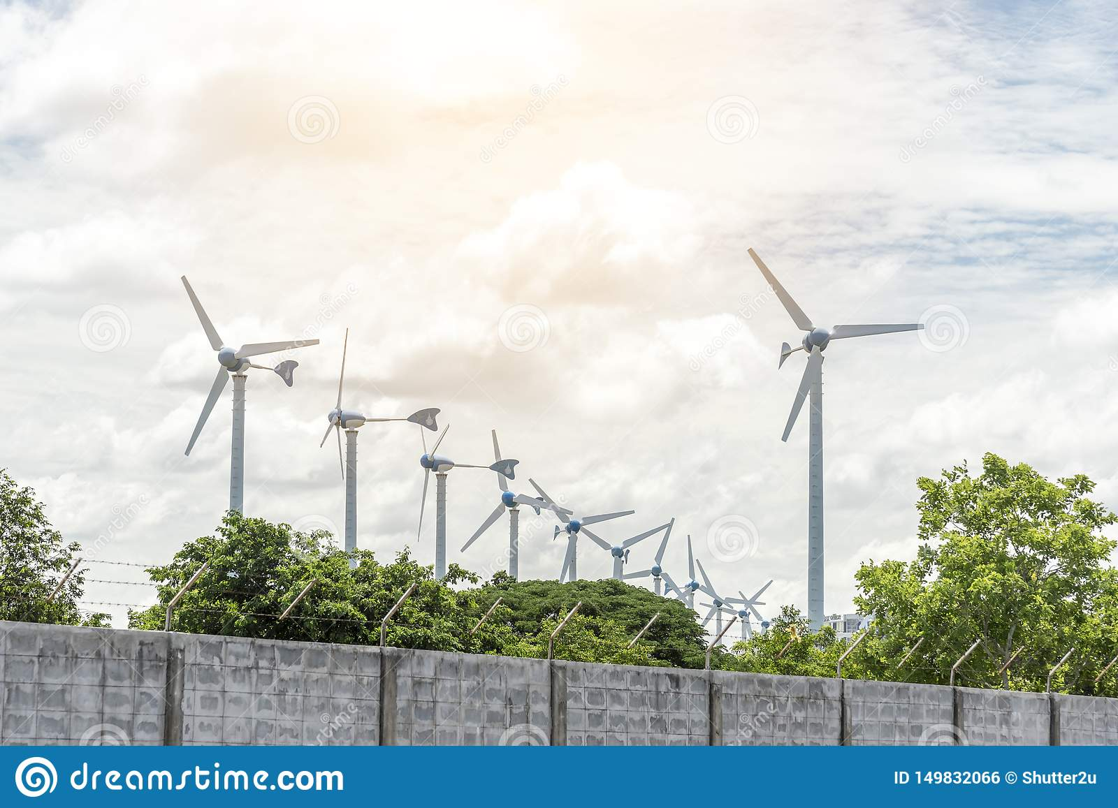 Electric wind mills for generating power fan, Technology and Nature concept